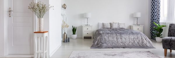 open and tidy bedroom with minimal stuff on night stands