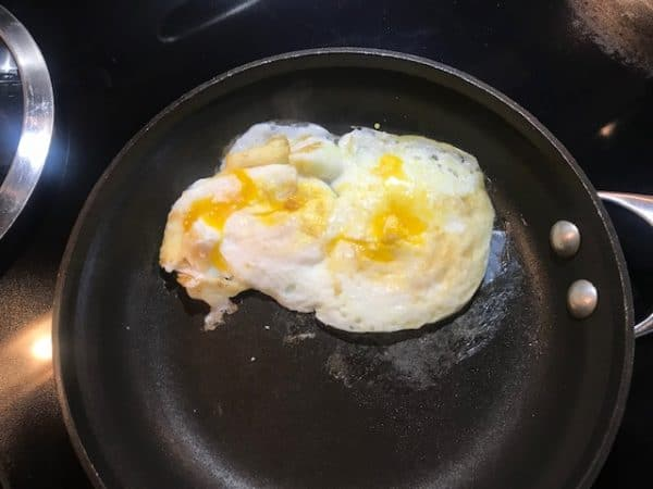 Fried eggs with broken yolks for a fried egg sandwich