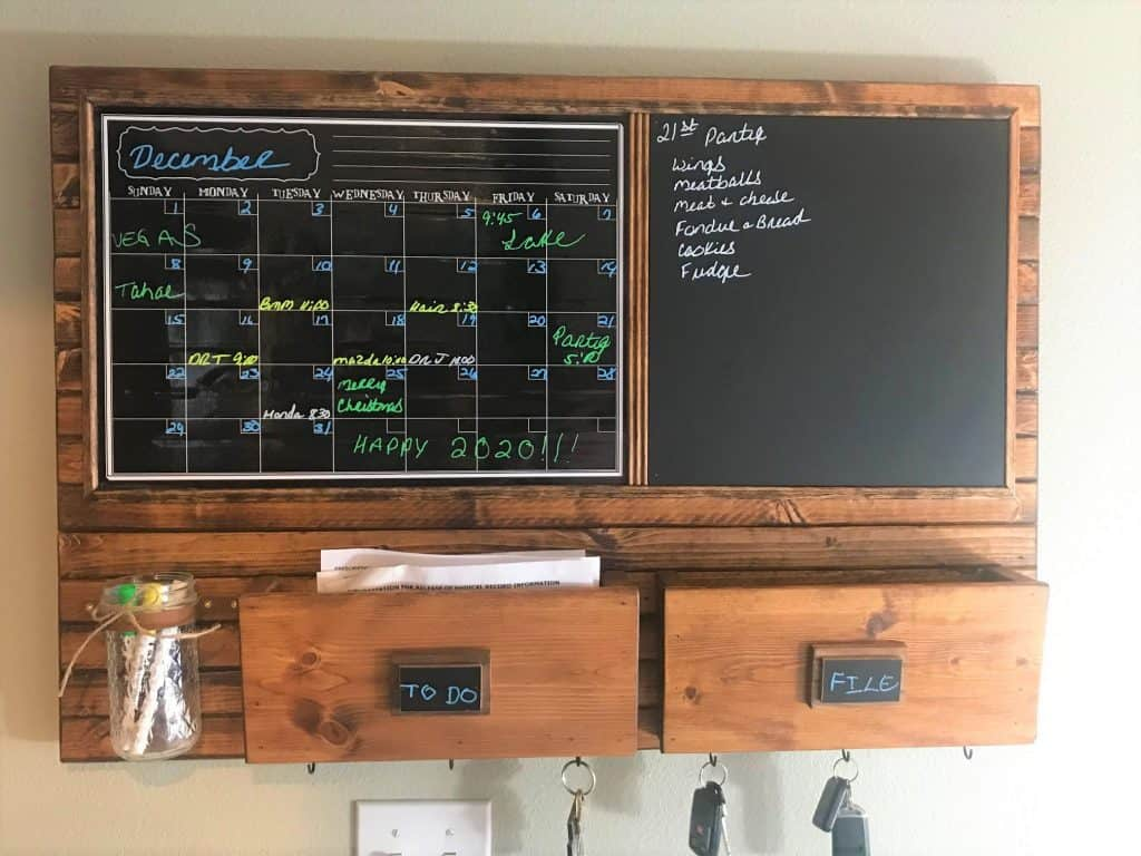 Harmony Boards command center with chalkboard, calendar, two mailboxes, and key hooks