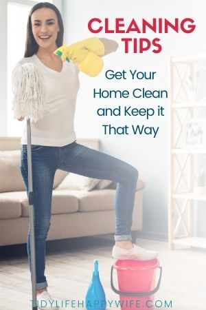 smiling woman with cleaning supplies