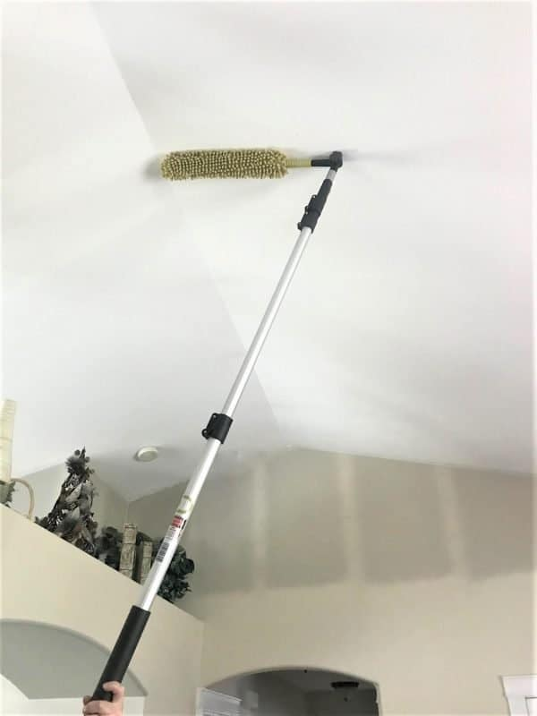 Dusting the ceiling during spring cleaning