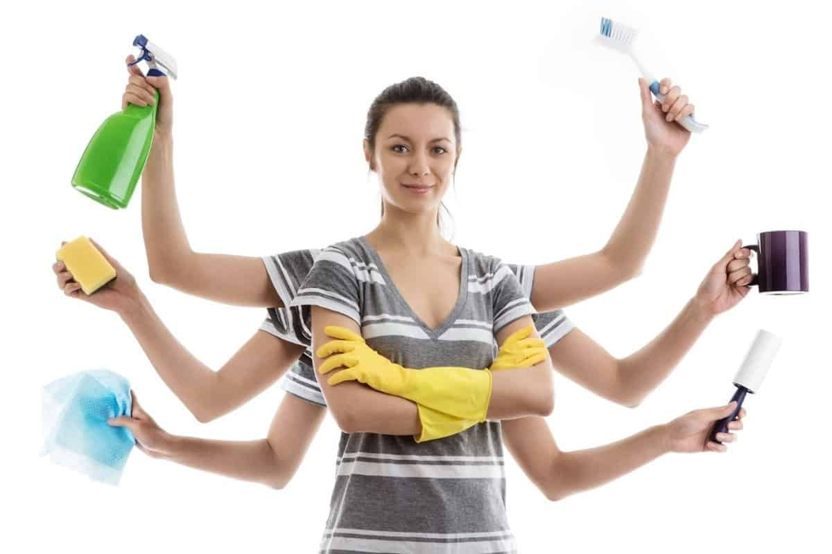Woman with 8 arms holding showing off her cleaning tips