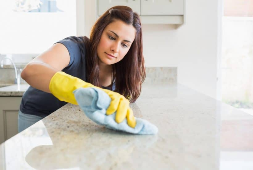 Clean freak lady cleaning a spot on the counter