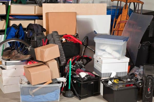 Garage cluttered with boxes and miscellaneous items