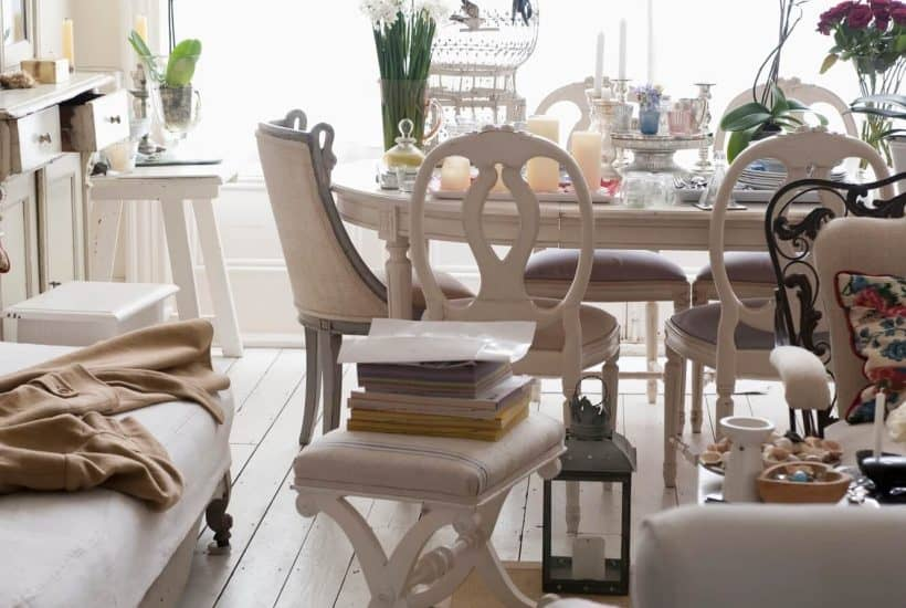 cluttered dining room that can be cleared out by asking these decluttering questions