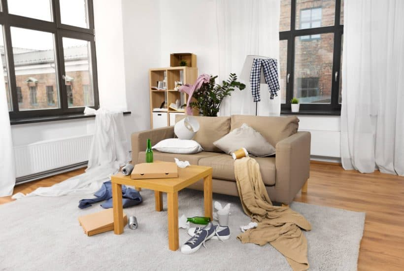 Messy living room to show how to declutter when you don't know where to start