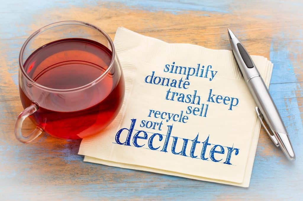 napkin with declutter word art - simplify, donate, trash, keep, recycle, sort, and declutter