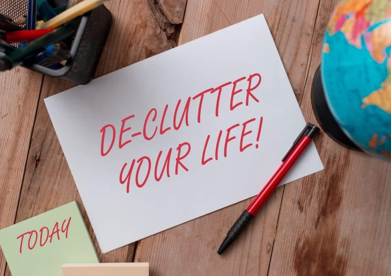 Declutter your life handwritten on a piece of notepad