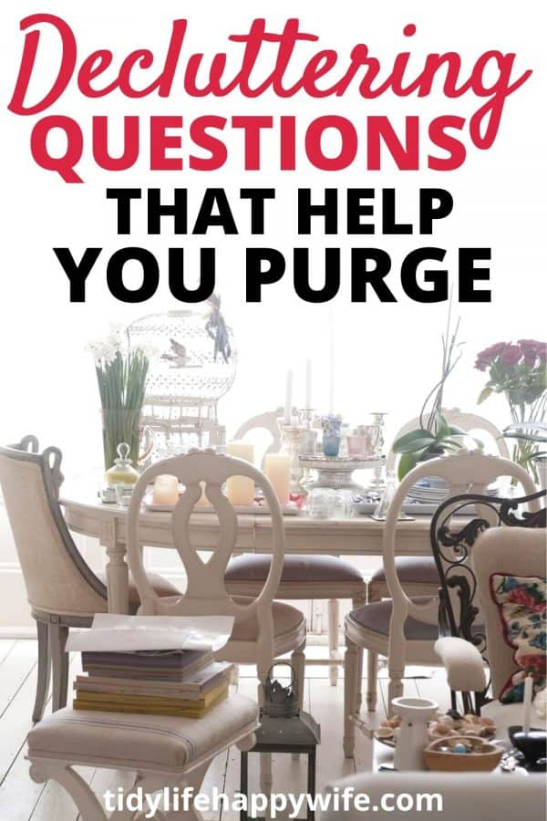 cluttered dining room table with decluttering questions that help you purge written above it