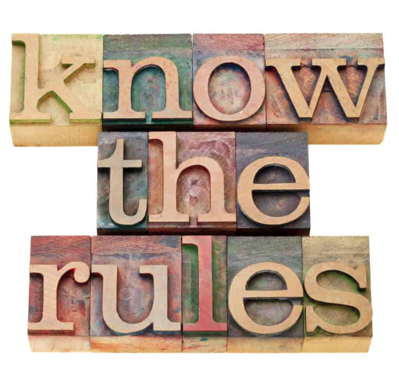 vintage wood sign stating 'know the rules'