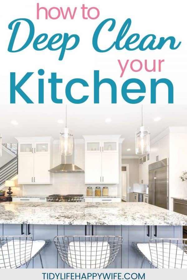clean white kitchen with granite counters - how to deep clean your kitchen