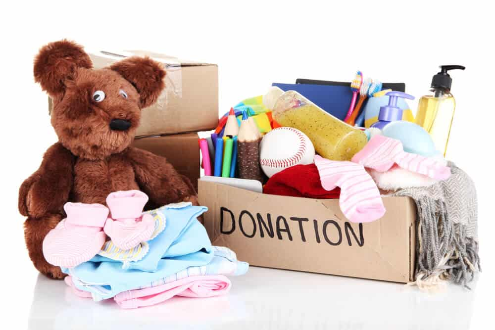Teddy bear, clothes and misc items ready to be donated after decluttering
