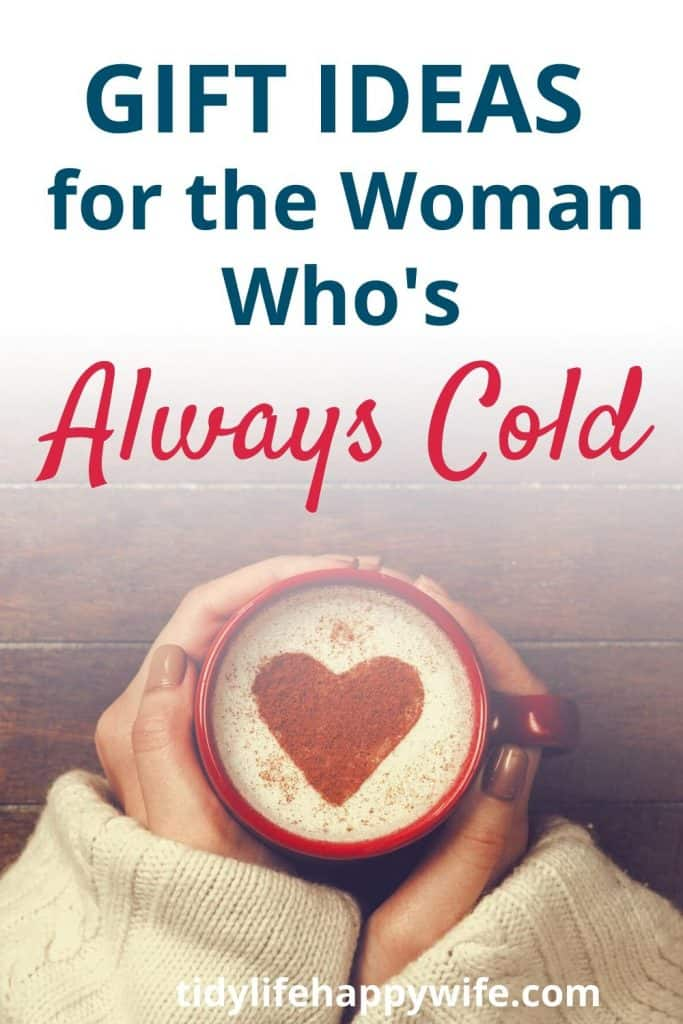 Cold woman holding coffee mug of of hot chocolate