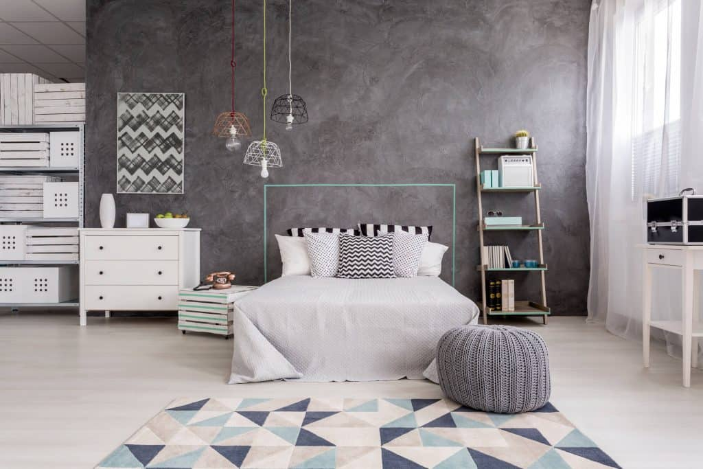 clean and tidy bedroom with gray wall and accents