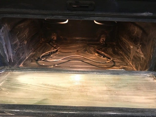 Interior of oven with cleaning mixture applied.