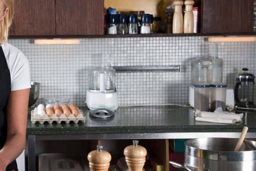 Food processor and other kitchen items on countertop