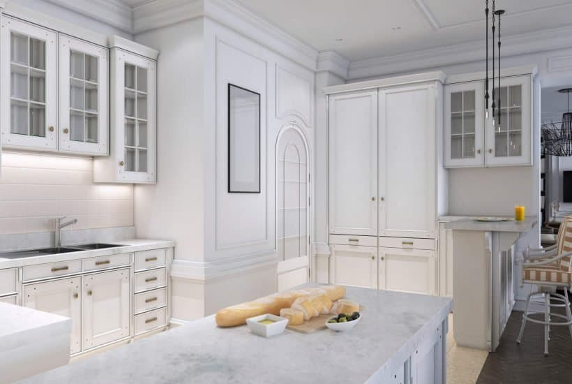 decluttered white kitchen with marble counters