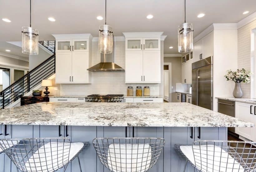 clean white kitchen with marble counters