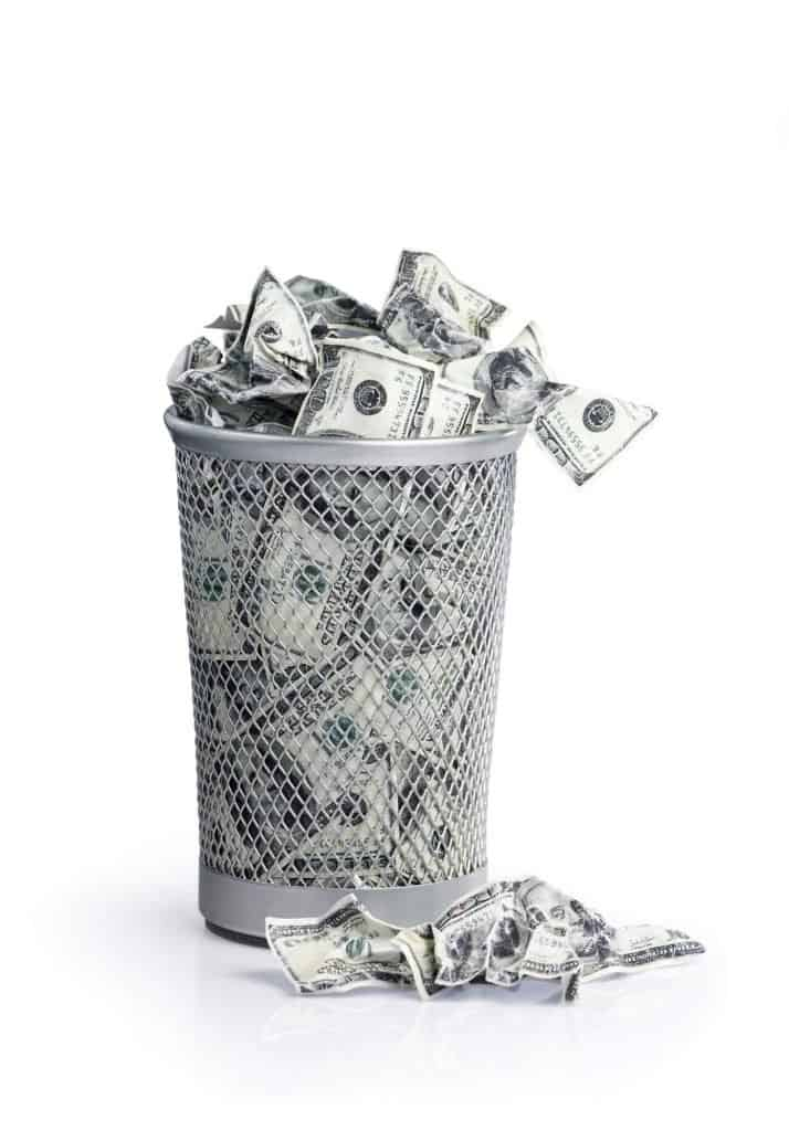 money in a trash can is what people imagine when decluttering