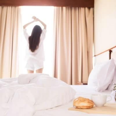 Woman stretching as par of her morning routine
