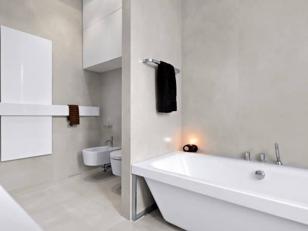 beige and white clutter free bathroom tub, toilet and cabinets