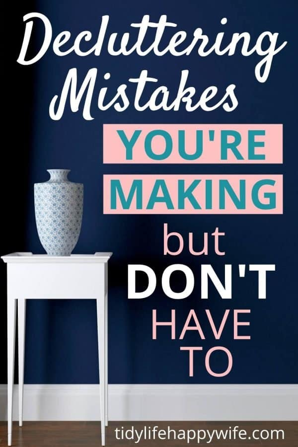 small white table with white vase sitting in front of blue wall with 'mistakes you're making but don't have to'