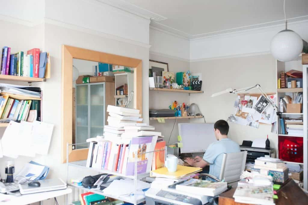 home office full of paper clutter