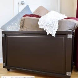 DIY rolling storage bin with bedroom blankets and pillows