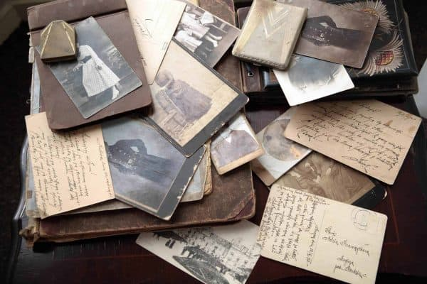 Collection of pictures, postcards, letters, and notes that contribute to sentimental clutter