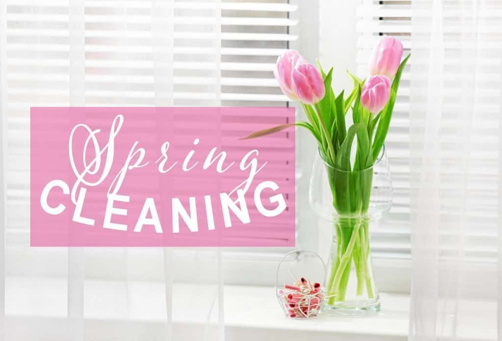 Spring Cleaning sign and a vase of tulips signal that it's time to pull out that Spring Cleaning Checklist