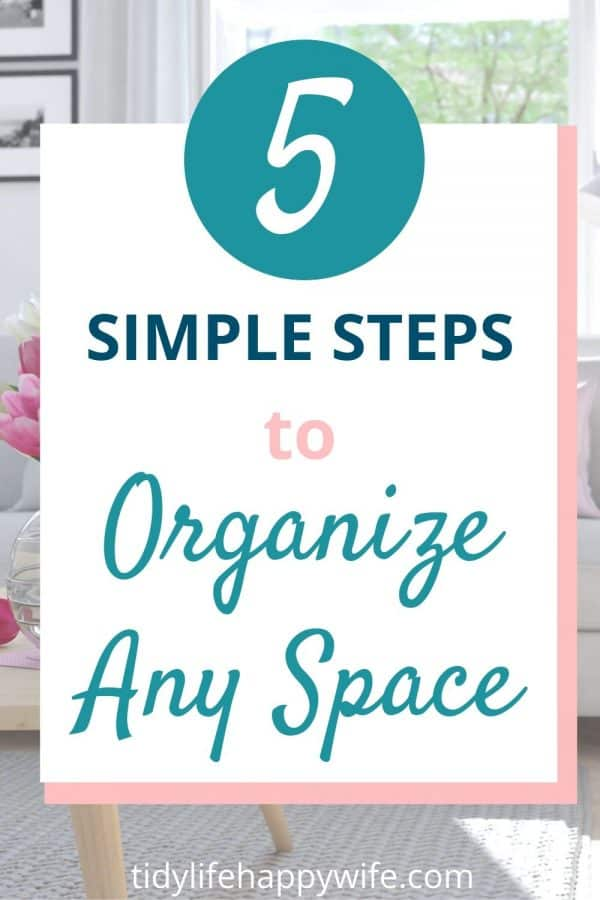 Organized living room using 5 steps to organize any space