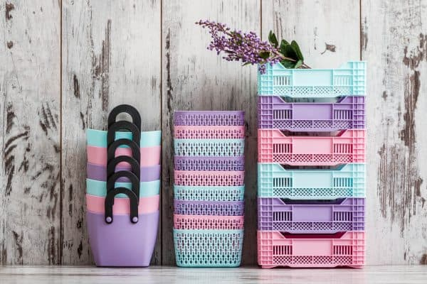 3 stacks of pastel colored organizing baskets