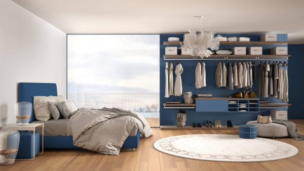 clean and tidy open concept bedroom with blue walls