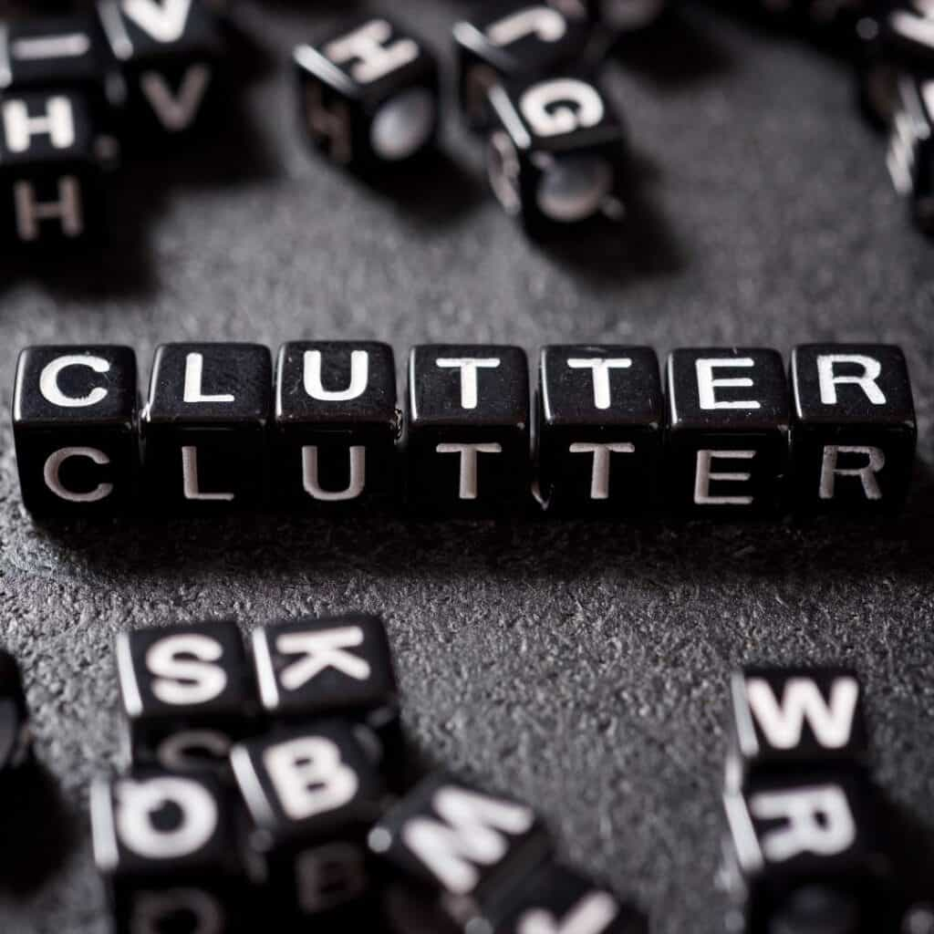 black dice that spell the word clutter