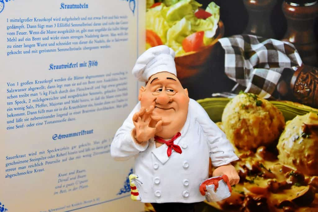 cartoon chef standing planning a meal