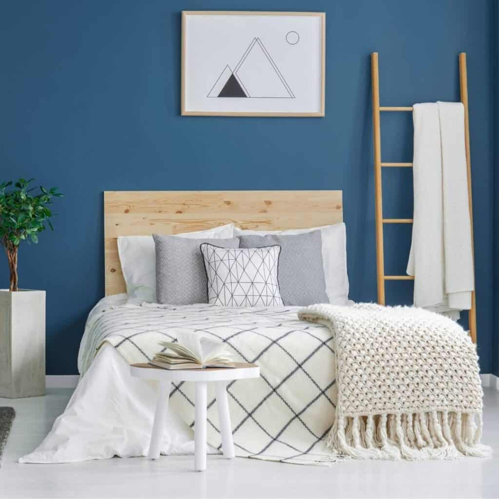 a neatly made bed that makes the bedroom look clean and tidy