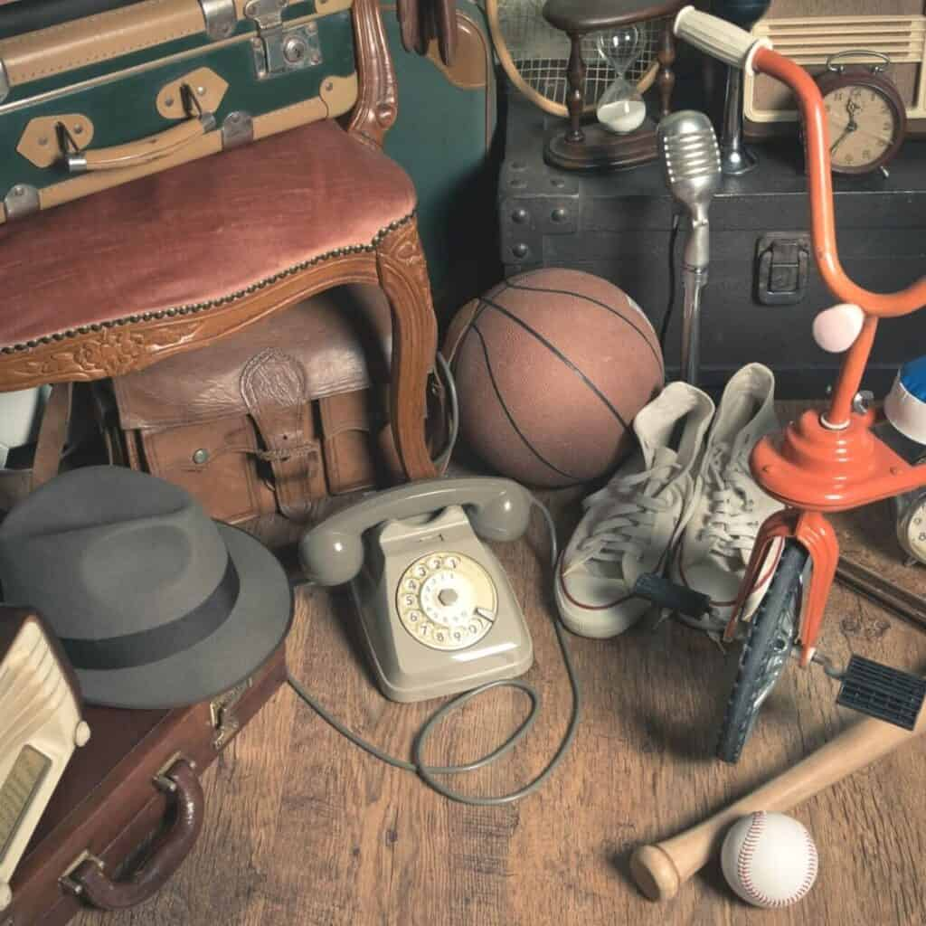 vintage sentimental items including a basket ball, baseball, bat, and tricycle